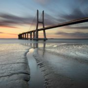 Posters Fototapeta City Bridge Beach Sun Portugal Sunset 254x184 cm - 115g/m2 Paper - Posters